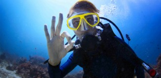 A beginner trying scuba diving in El Nido's clear waters
